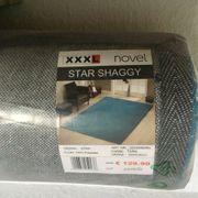 neuer Teppich eingepackt von XXXL