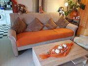 Tausche große beige farbene Couch