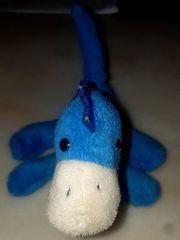 Kuscheltier kleiner Dino