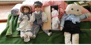 Alte Puppen und Puppenwagen