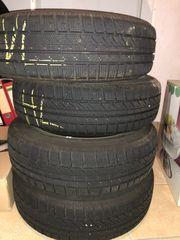 Winterreifen Bridgestone mit MINI Radblenden