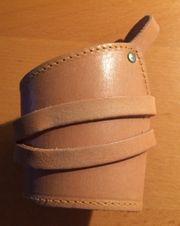 Handgelenkbandage aus Leder linke Hand