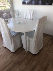 Weißer Esstisch mit 4 Stühlen