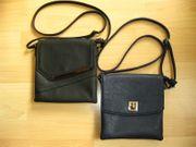 Taschen Handtaschen schwarz und blau