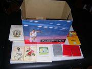 Kiste voller kleiner Bücher zu