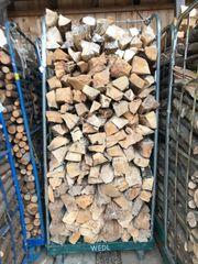 Brennholz Ofenholz im Wagen