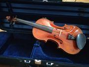 2 schöne alte Geigen